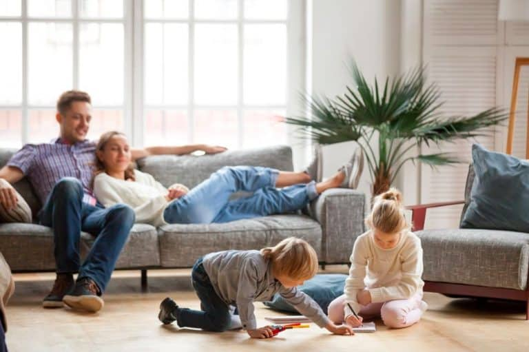 Couple on lounge with children